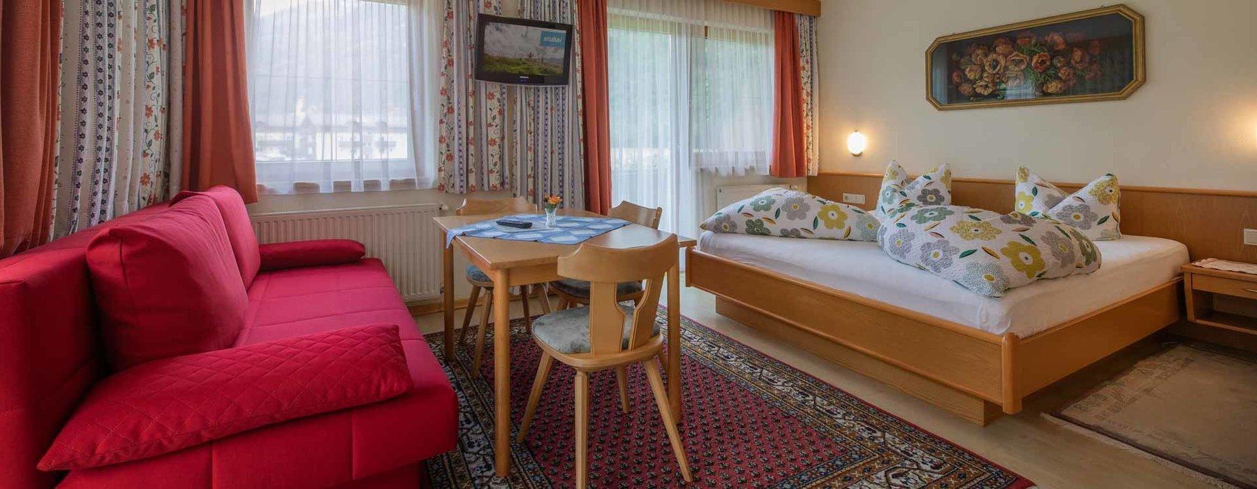 Eines der Schlafzimmer in einem Niggnhof Appartement